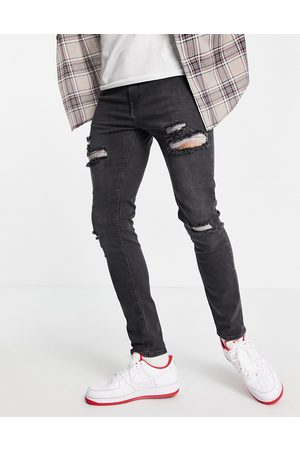 ASOS Skinny jeans in washed with heavy rips