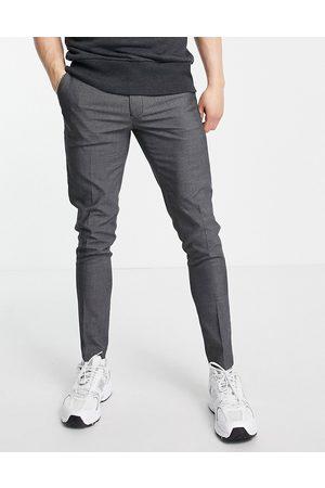 ASOS Super skinny smart trousers in charcoal pin dot