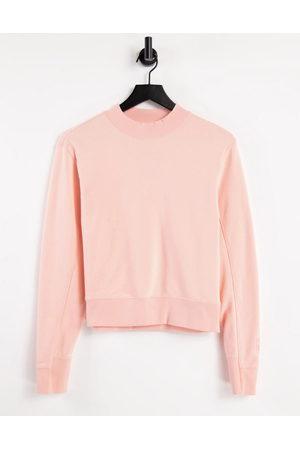 PUMA Infuse crew sweatshirt in peach