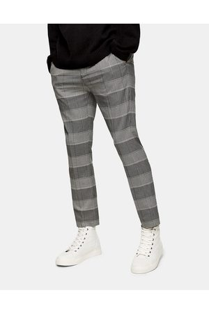 Topman Stretch skinny joggers in and stone check