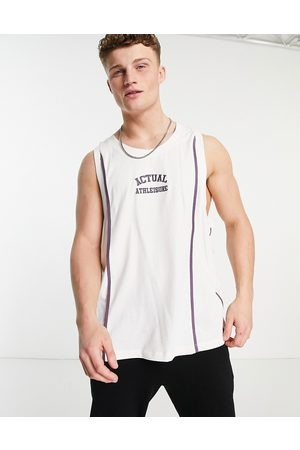 ASOS Athleisure basketball vest in ecru with embroidered chest logo and seam detail