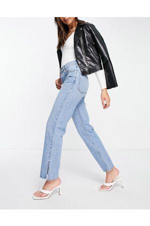 ASOS Low rise straight leg jeans in midwash with split hem