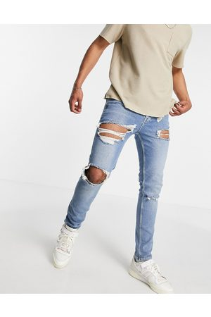 ASOS Skinny jeans with rips and destroyed hem in vintage mid wash