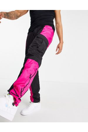 Karl Kani Signature cargo trousers in /pink