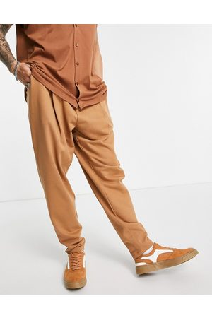 ASOS Organic oversized wide leg joggers with pressed pleat in
