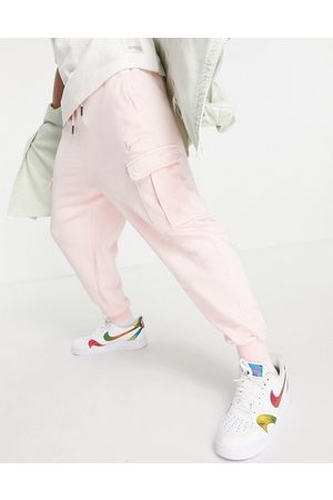 Karl Kani Small signature washed cargo joggers in rose