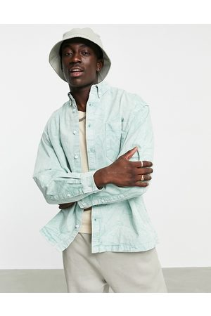 ASOS Boxy oversized shirt with bleach wash in sage