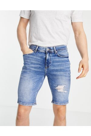 River Island Skinny denim shorts with rips in