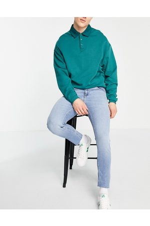ASOS Stretch slim jeans with 'less thirsty' wash in light with raw hem