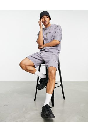 ASOS ASOS Unrvlld Spply co-ord relaxed shorts with cut & sew nylon panels in