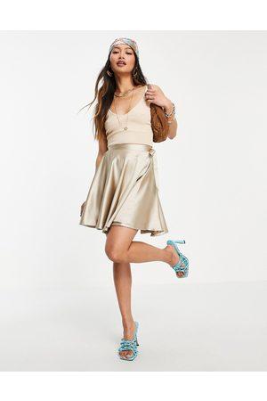 Flounce London Women Sets - Satin mini wrap skirt co-ord in champagne