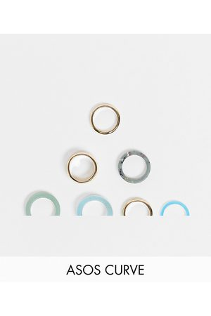 ASOS ASOS DESIGN Curve pack of 7 rings in mixed plastic and gold tone-Multi