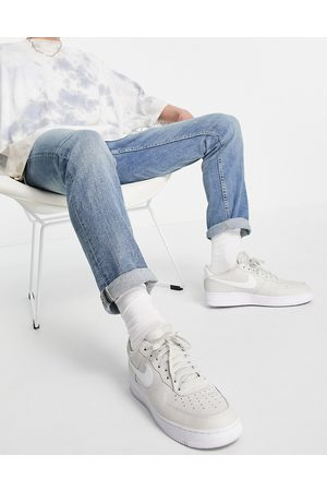 New Look Slim jeans with chain in mid wash