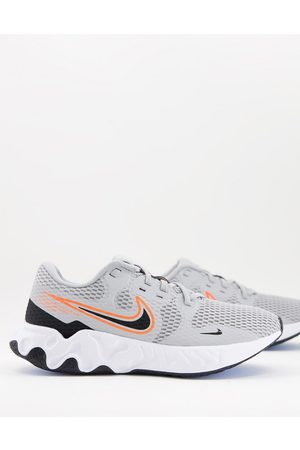 Nike Renew Ride 2 trainers in and orange