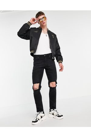 ASOS Stretch slim jeans with knee rips in washed