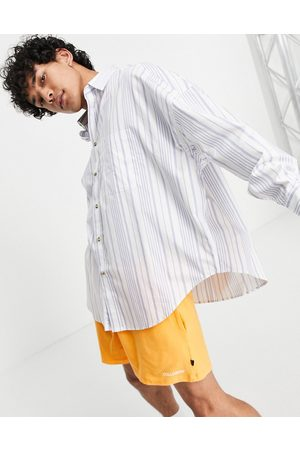 ASOS Extreme oversized shirt in navy stripe with curved hem