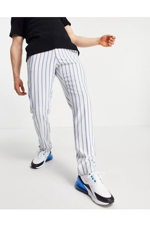 ASOS Slim soft tailored suit trousers with stripe and jogger waistband