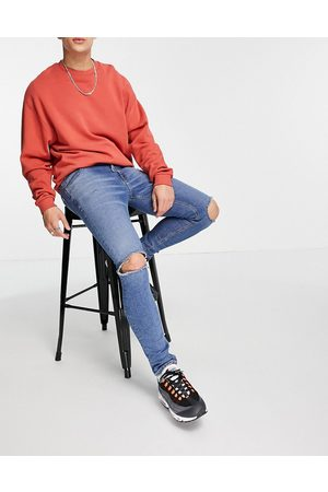 ASOS Skinny jeans with 'less thirsty' wash in mid with knee rips