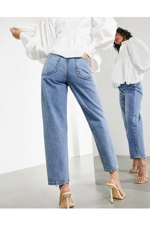 ASOS Tapered jean with twisted seam in mid wash