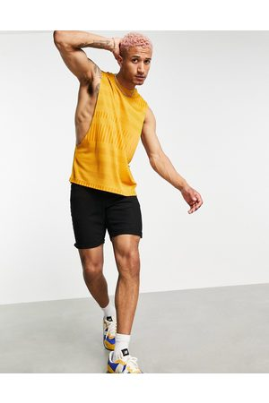 ASOS Relaxed vest with dropped armhole in mustard rib