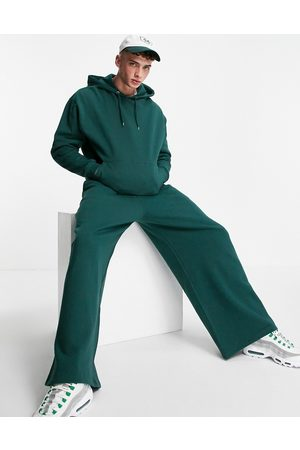 ASOS Oversized tracksuit with hoodie and wide leg joggers in forest