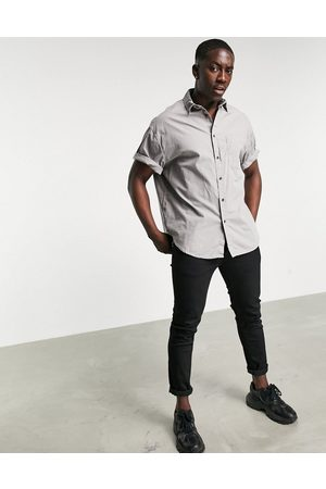 ASOS Boxy oversized washed poplin shirt in charcoal