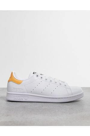 adidas Stan Smith trainers in with gold heel tab