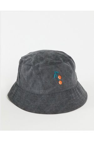 ASOS Washed bucket hat with cherry embroidery in