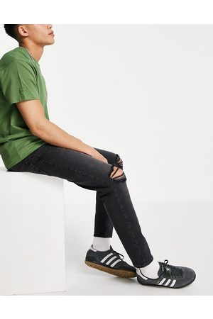 ASOS DESIGN Men Tapered - Stretch tapered jeans in washed with rips