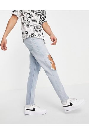 ASOS Slim jeans with knee rips in vintage light wash