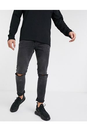Topman Stretch skinny jeans with knee rips in washed