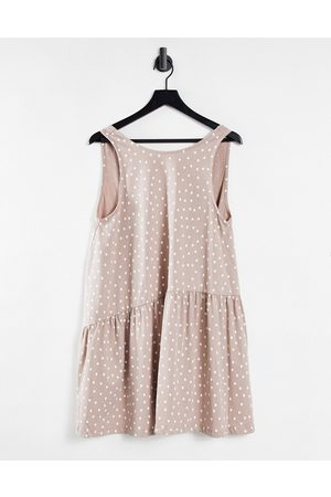 ASOS DESIGN Sleeveless smock dress with v back in mink and white spot