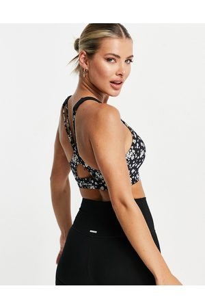 Lorna Jane Medium support sports bra in daisy print