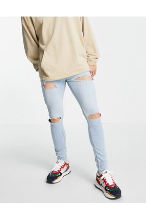 ASOS Spray on jeans in power stretch with 'less thirsty' wash in light with rips
