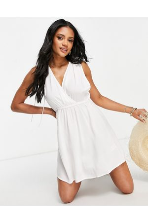 ASOS DESIGN Recycled gathered detail mini beach dress in
