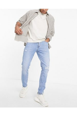 River Island Slim jeans with rips in light
