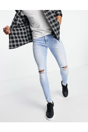 River Island Spray on jeans with rips in light