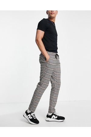 ASOS DESIGN Slim trousers with elasticated waist in brown check