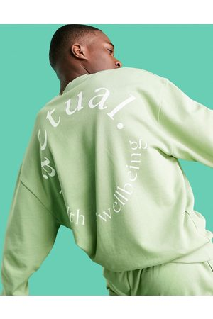 ASOS Actual Athleisure oversized sweatshirt in with health and wellbeing logo largeback print