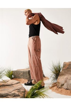 ASOS DESIGN Wide fit trousers with carpenter pockets in texture