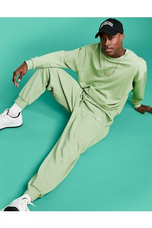 ASOS Actual Athleisure relaxed joggers in with health and wellbeing logo print