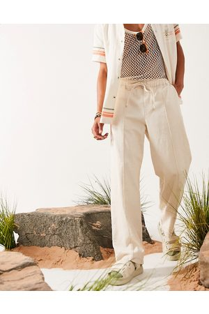 ASOS DESIGN Linen mix wide leg trousers with pin tuck-Neutral