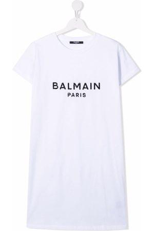 Balmain TEEN sequin-logo embellished T-shirt dress