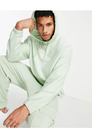 ASOS Oversized polar fleece hoodie in light with logo