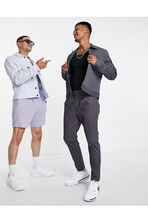 ASOS DESIGN Men Chinos - Cigarette chinos with pleats in charcoal