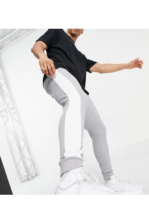 ASOS Men Joggers - Organic skinny joggers with side stripe in marl