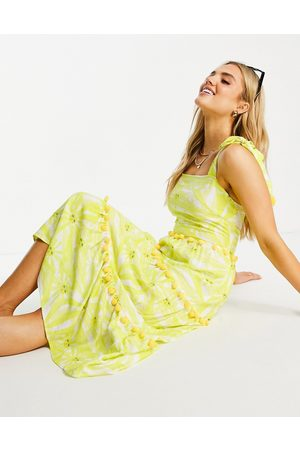 Never Fully Dressed Women Printed Dresses - Tiered midi sun print dress with pom pom details in