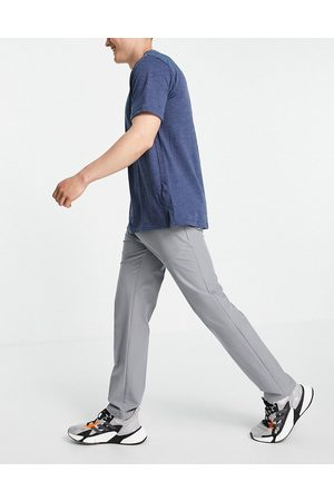 adidas Ultimate tapered trousers in