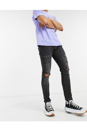 Topman Organic cotton blend stretch skinny jeans with rips in washed