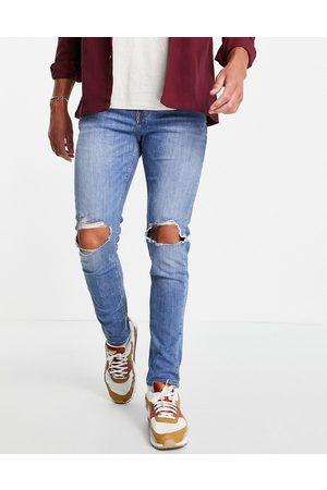 ASOS Men Skinny - Skinny jeans in mid wash with knee rips
